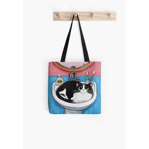 Fette Schwarz-Weiß-Katze im Waschbecken Tasche