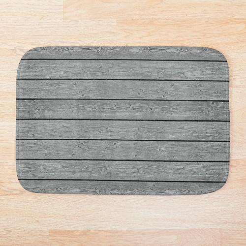 Graue Holzverkleidung Badematte