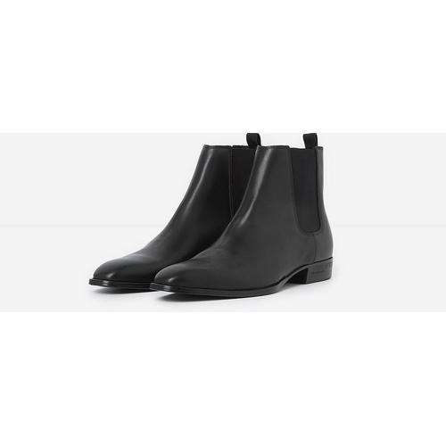 The Kooples Flache schwarze Chelsea-Boots aus Leder