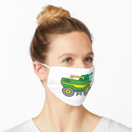 Mähdrescher bei der Ernte Maske