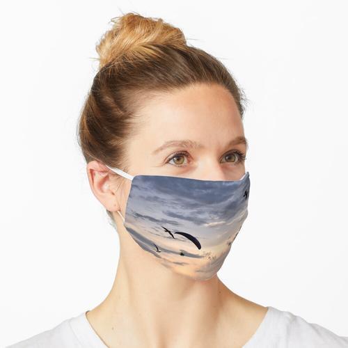 Paramotor in einem Pfirsichhimmel Maske