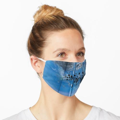 Blau gestrichene Wand Maske