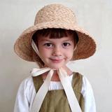 Chapeau de soleil en raphia tric...